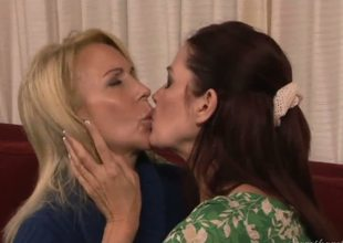 Awesome mature dykes Erica Lauren and Magdalene St. Michaels are having some hot making out on the bed and they look rather pretty and arousing in the process