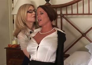 Very pretty and very busty bitches Nina Hartley and Rachel Steele are engaging in a hot sapphic encounter and they look incredibly hot in the process.