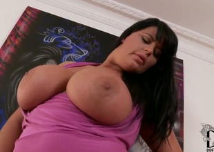 Milf Rebecca Jessop with giant tits and bald snatch masturbating with big desire