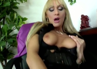 Cherry Cream is looking like a million bucks in her taut outfit and black nylons as she discloses more and more of her body and as she starts banging that large pink toy to make herself cum.