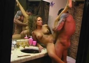 Bathroom counter fuck with a slutty big tits milf