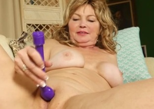 Mom plays with her anal opening while masturbating