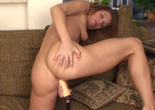 Vibrators and a dildo make the horny mom happy