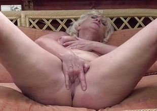 Mature amateur rubs her warm pussy