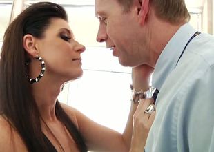 India Summer gives Mark Wood a blow job in the bathroom. This dark haired temptress looks absolutely stunning as she sits astride the toilet seat in her hot underwear and fish net stockings as she sucks on Marks hard cock.