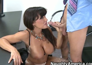 Seth Gamble just started working in the firm and Lisa Ann is already unleashing her milf sucking and fucking skills on his enormous dick. This curvy milf chick can go for hours!