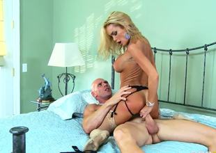 Tanned experienced pornstar blonde whore Devon with large tits and hot ass in slutty lingerie and stripper shoes rides on bald horny Johnny Sins with muscled hot body