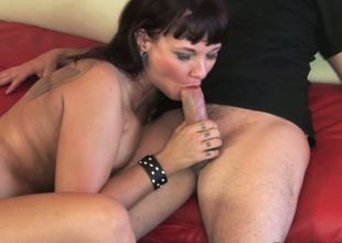 The beautiful brunette milf Carrie Ann is ready to get her throat filled with the sticky cumshot and this babe is zealously swallowing the rock hard stick and petting it with hot tongue