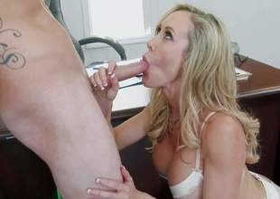 Boss Brandi Love is a good looking mature blonde with perfect huge tits. She strips down to her underclothes in front of her new employee and takes his fat young dick in her eager mouth