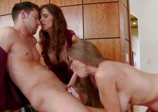 Darla Crane and Syren De Mer are sex hungry milfs that have a crush on new guy Seth Gamble. These hot milfs team up and give him some pleasure. They get nude then suck and ride his knob at the office