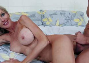 Emma Starr is a breathtaking golden-haired milf with hard athletic body and flawless huge fake tits. She gets her wet tight pussy banged deep and hard by her sons buddy in the shower and then again in the bedroom