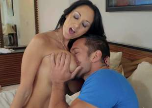 Smoking hot black haired milf Ava Addams with biggest juicy knockers and hawt tattoo on above delicious ass gives head to muscled Johnny Castle and gets boned deep in bedroom