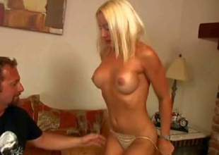 Blonde and horny milf with nice body and firm natural boobs enjoys in getting her clothing off and giving head on her knees in front of the camera in a pov video