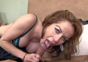 Kora Peters is a dick hungry mature woman that is good at cock sucking. Passionate mom in bra turns asian guy on and takes his hard exotic cock in her eager mouth. Watch cougar do oral job
