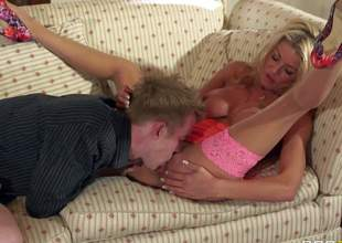 Gorgeous and arousing blonde bombshell Tia Layne enjoys in giving a hot titjob on her knees and getting a hot pussy licking and drilling after that from Danny D