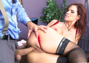 Syren De Mer is a redhead milf wearing lingerie and stockings. Shes about to acquire fucked by a younger guy whos crazy for milfs. Shes such a hot dirty cougar.