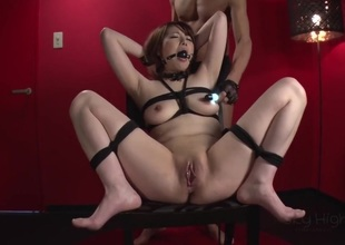 Asian babe is doing bondage