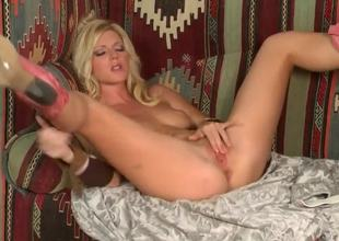 Blonde temptress, named Niki Young, demonstrates on the camera how she masturbates her pussy. Babe makes her hole wet by gentle touches on her sensitive boobies.