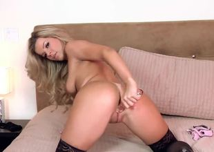 Kelly Collins just came from the meeting with her new lover. She is so excited. This lady wants him and starts to masturbate in her shoes in her bed!