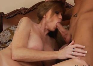 The voluptuous milf Darla Crane with a beautiful natural boobs makes the deepthroating for her son Billy Hart, then he professionally licks her hawt pussy and they fuck very passionately.