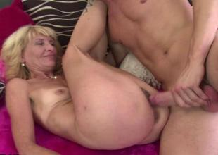 Slim mature gets drilled by a young chap