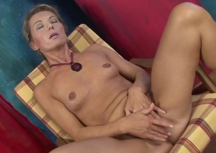 Tanned solo mommy with nice small tits plays with her cunt