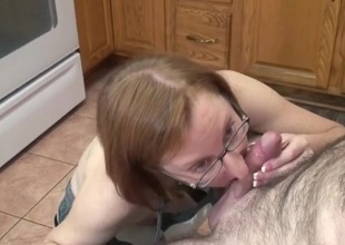 Housewife in rubber gloves sucks a cock