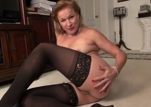 Mature lady in stockings has a hairy bush