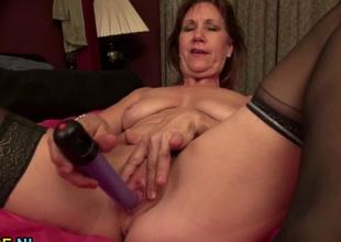 Excited mature taking off her black lingerie and toy