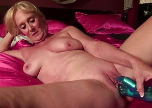 Close-up shooting of mature pussy getting toyed