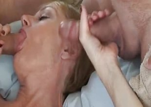 Blonde gilf sucking cock in threesome