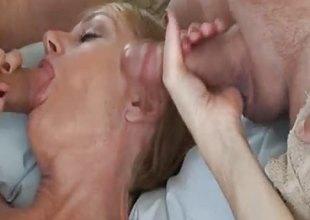 Blonde gilf sucking cock in threesome