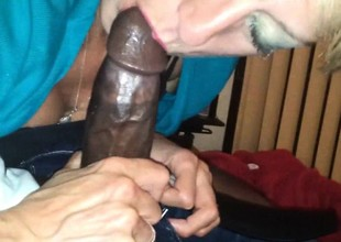 Concupiscent grandma eating a big black cock.
