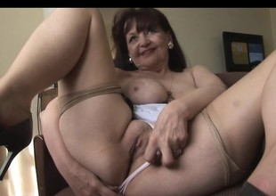 Busty mature babe in taut dress and nylons