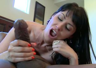 Experienced lusty cock hungry turned on skillful brunette milf Eva Karera with giant flawless melons and taut ass gives blowjob to muscled black stud with stiff boner in bedroom