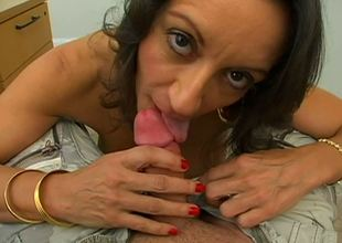 The beautiful big titted brunette milf Persia is sitting in front of the guy taking his big and fat piston in mouth and also wrapping that amazing stuff with the soft melons