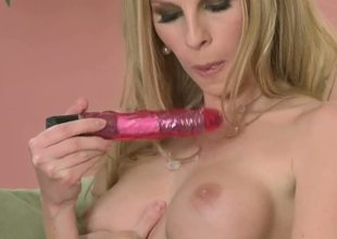 Mature Aimee is awesome! All men fantasies about hot nasty sex with this big boobed curve. But she takes her toy and masturbates her pussy making it wet and delicious.