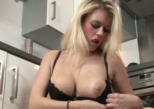 Brook Little is a tempting blond MILF with gorgeous natural boobs and fine booty. This sexually excited mom cant resist playing with herself while cooking a dinner in the kitchen.