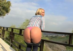Arousing short haired golden-haired milf Melanie Monroe with big fake tits and juicy ass gets naughty and reveals her hot curves while teasing outdoor in point of view.