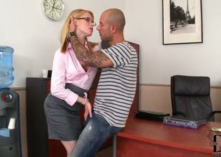 Experienced blonde pornstar slut Amber Daikiri with hot body dressed as secretary with glasses in high heels teases and seduces hot tattooed stud in her office