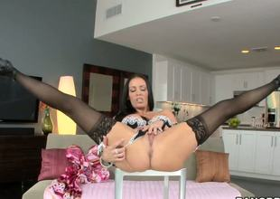 This is the horny milf Vanilla DeVille which is demonstrating her delicious big titted body wrapped into the sexy and hot lingerie and masturbating the burning cunt