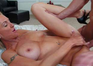 Emma Starr is s good looking mature blonde with incredibly sexy big fake tits. This well-stacked cougar with hard body receives her fuck hole filled with hard young dick and loves it so much!