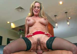 Lingerie-clad blonde milf Brandi Love with incredibly hot body shows off her delicious assets as she gets her snatch licked and fucked by lucky dude. Horny woman with big tits and nice ass does it with passion
