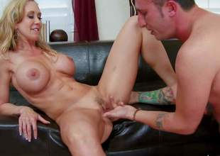 Sexy bodied mature lady Brandi Love with massive firm tits strips out of her tempting black underware in front of handsome young fellow and makes his hard dick disappear in her mouth. Then she takes his love torpedo up her pussy. Shes his sex teacher!