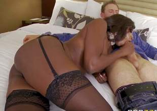 Dark skinned milf Diamond Jackson is a call angel with nice body. Leggy ebony woman in black nylons shows off her bubble a-hole and biggest tits as she sucks white guys beefy cock on the bed