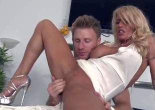 Shes a super sexy milf with golden-haired hair and perfect long slim legs. She removes her white panties and gets her tight absolutely shaved pussy finger fucked and fisted by MILF Hunter. He love sher tight hole