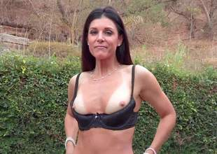 Tall brunette India Summer is a nice-looking milf with perfect body. Long haired slim woman strips down to her lingerie. She displays her bush and her round bare ass outdoors with no shame