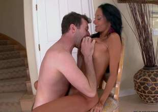 Tanned black haired bombshell Ava Addams with large juicy tits and juicy ass gets her shaved fur pie licked by randy pale stud in living room on a lazy afternoon
