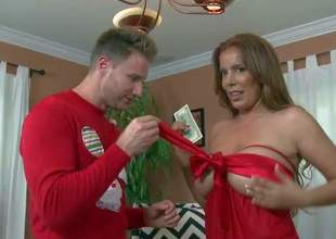 Shes a smoking hot sexy milf dressed in red. She turns MILF Hunter on with her gorgeous body. She bares her big butt cheeks and then bares her massive titties. Shes damn sexy!