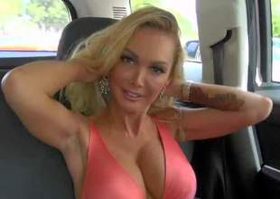 Devon is a charming blond-haired milf that can not hide her huge round boobs under her top. Charming well stacked babe makes her eyes on cam in the backseat of a car. See her get turned on by MILF Hunter